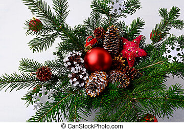 Christmas table centerpiece with golden decorated pine cones and snowflakes