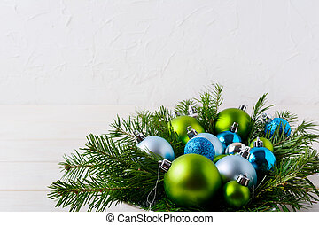 Christmas table centerpiece with light blue, glitter and green ornaments