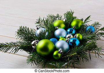 Christmas table centerpiece with silver, blue and green ornaments