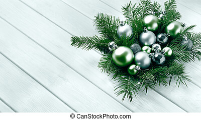 Christmas table centerpiece with silver and green ornaments