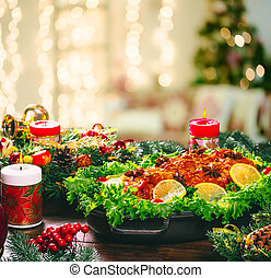 Christmas table dinner time with roasted meats decorated in...