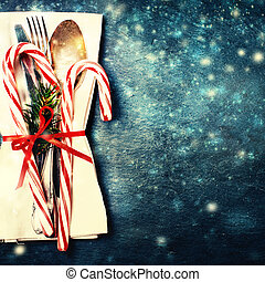 Christmas table place setting with christmas tree branches,...