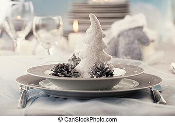 Christmas table setting. Restaurant place setting in elegant...