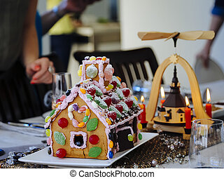 Christmas table setting with gingerbread house