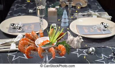Christmas table with shrimps and champagne - Beautiful...