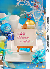 christmas table with small easel on the plate