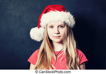 Christmas Teen Girl in Santa Hat on Dark Background