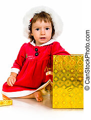 little girl in santa hat with presents