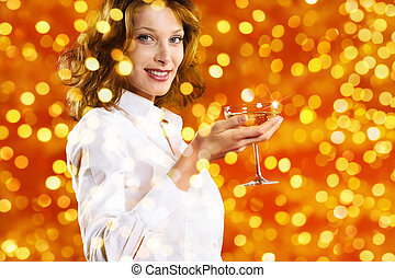christmas theme, smiling woman toast to the new year with glass