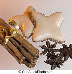christmas theme with cinnamon sticks, stars and spice