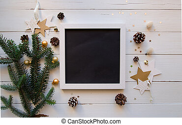 Christmas theme with frame, and on white wooden background