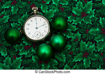 Christmas Time - A pocket watch with green glass balls on a ...