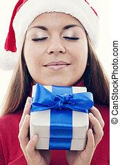 Christmas time - Beautiful woman holding present
