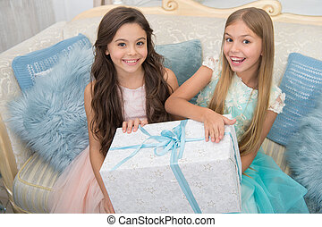 Christmas time. Child enjoy the holiday. Christmas tree and presents. Happy new year. Winter. xmas online shopping. Family holiday. The morning before Xmas. Little girls