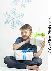 Christmas time - Child holding wrapped Christmas pressents ...