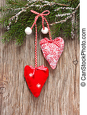 Christmas time. - Christmas decoration with two hearts on an...