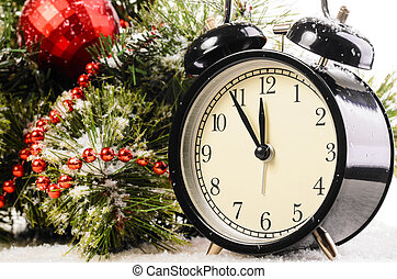 christmas time - clock on snow under decorated christmas ...