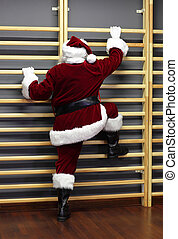 Christmas Time form preparation - santa claus exercising wh...