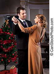 Christmas Time - Lovely young couple dancing in a romantic ...