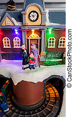 Christmas time miniature street scene with colored lights