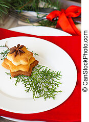 Christmas time table decoration with rose hips and tea with...