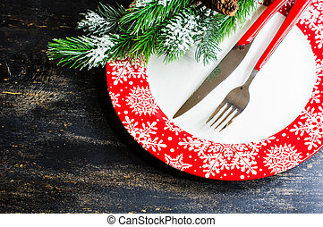 Christmas time table setting with bright red silverware,...