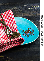 Christmas time table setting with silverware, plate and...