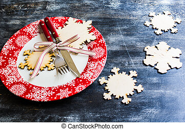 Christmas time table setting with vintage silverware on...