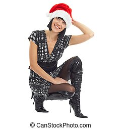 Christmas time. Young woman wearing Santa hat.