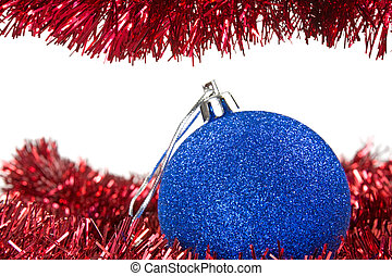Christmas tinsel and blue bauble