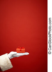 Christmas token - Santa Claus gloved hand with small package...