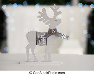Christmas toy deer on the background of Christmas background with bokeh.