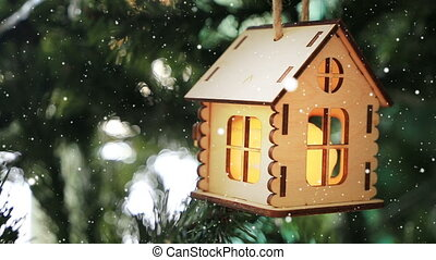 Christmas toy house in bright green moss and fir branches ...