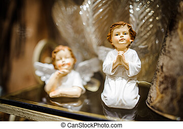 Christmas toy in the form of two cute porcelain praying angels