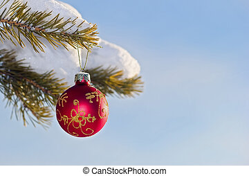 Christmas toy on a branch