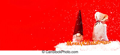 Christmas toy Santa Claus and a bag with gifts on a red background.Christmas greeting card. Creative copy space.