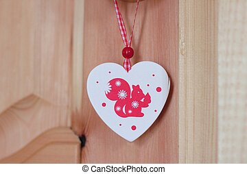 Christmas toy squirrel in the heart.