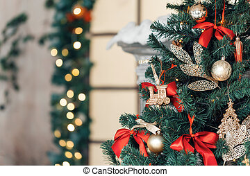 Christmas toy train and garland on the fir tree