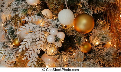 Christmas toys hanging on a pine tree in gold style