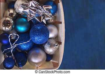 Christmas toys in box on a blue background