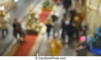 Christmas toys on the background of blurred people walking...