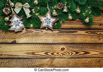 Christmas traditional decoration with fir branch on vintage wooden background