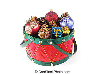 Various holiday decorations in a red drum isolated