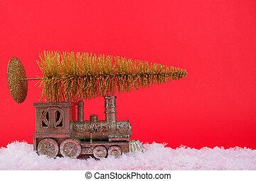 Christmas train carries a golden Christmas tree