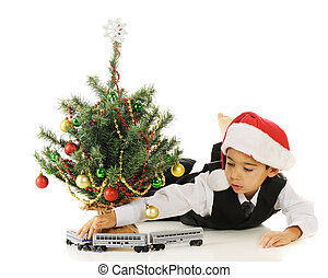 Christmas Train - A kindergarten boy driving his toy train...