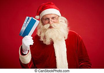 Christmas travel - Portrait of joyful Santa with airline...