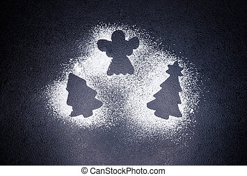 Christmas tree and angel from flour on a gray concrete background