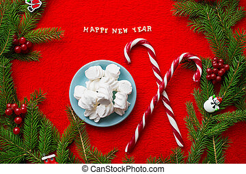 Christmas tree and candy on a red background with the words Happy New Year!