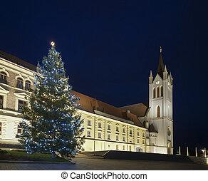 Christmas tree and church tower at night, Keszthely, Hungary