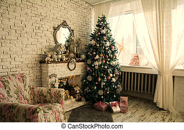 Christmas tree and fireplace with an armchair. The mirror in...